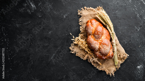 Foto auf Gartenposter Brot Braided bread with flour. Top view. Free space for your text.