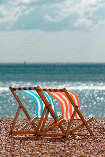 Photographie Empty Deckchairs on Beach