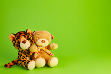 Teddy Bear; And A Toy Leopard Green Background