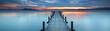 Leinwandbild Motiv magisches Licht am alten Holzsteg am See