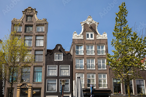 Traditional historic Dutch gable houses beside canal in Amsterdam The Netherland Canvas Print