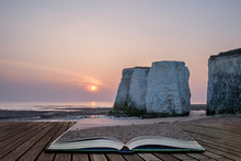 Beautiful Vibrant Sunrise Over Rock Stacks On Beach At Low Tide Coming Out Of Pages Of Open Story Book