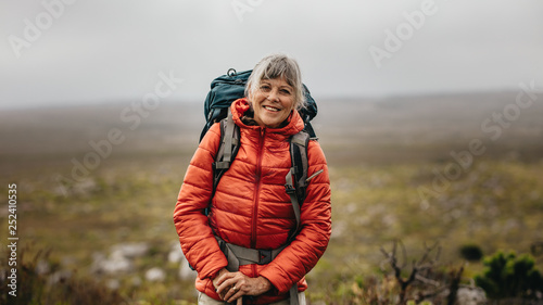 Female hiker standing on a hill
