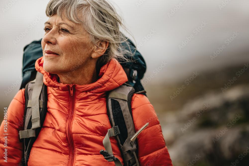 Fototapety, obrazy: Senior woman on a hiking trip