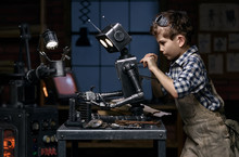 Young Mechanic Repairing The Robot In His Workshop