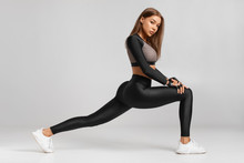 Fitness Woman Doing Lunges Exercises For Leg Muscle Workout Training. Active Girl Doing Front Forward One Leg Step Lunge Exercise