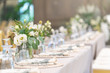 canvas print picture - Setting of tables for Wedding celebration dinner with a white bouquet and beautiful flower.