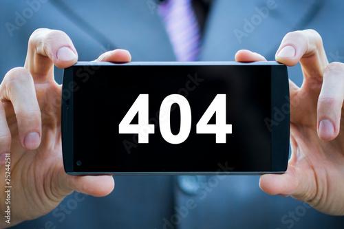 Fotografia  Businessman presses button http 404 error web on phone virtual electronic user i