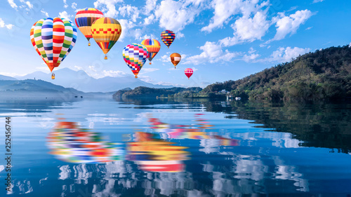 Poster Montgolfière / Dirigeable Colorful hot air balloon fly over beautiful landscape view of Sun Moon Lake 1