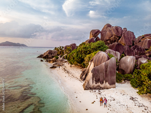 Foto auf Leinwand Weiß Aerial drone view of couple on the tropical beach of the Seychelles island