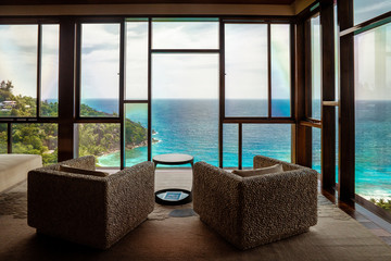 luxury beach chairs looking out over ocean of Praslin Seychelles