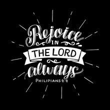 Hand Lettering With Bible Verse Rejoice In The Lord Always On Black Background.
