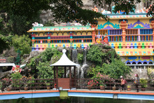 Pond With Artificial Waterfalls In The Batu Caves Complex