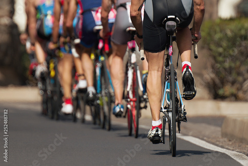 Foto op Aluminium Cycling competition cyclist athletes riding a race at high speed