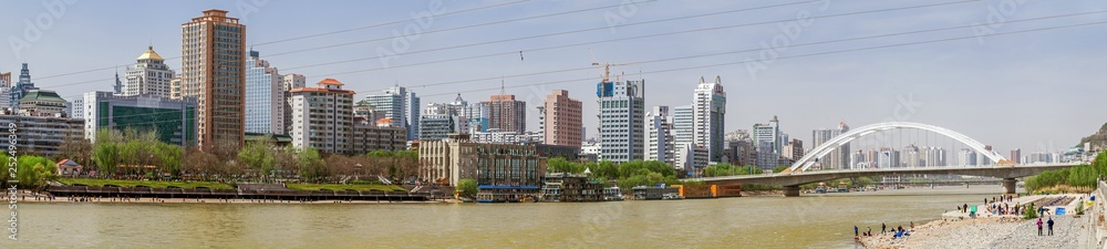 Fototapety, obrazy: Modern high-rise buildings constructed on the south bank of the Yellow River(Huang He) at Lanzhou, Gansu province, China.
