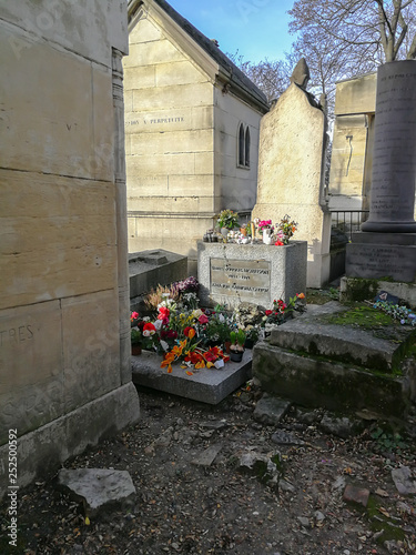 Photo  Grave of Jim Morrison at the Pere Lachaise Cemetery in Paris
