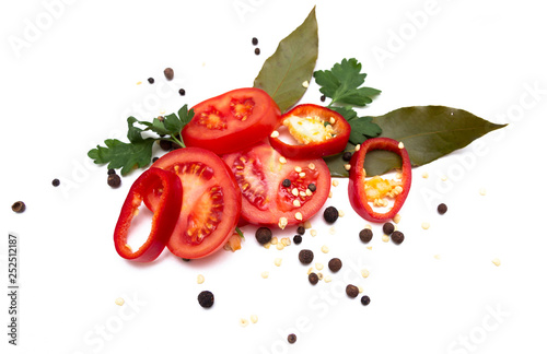 Fotografía  Sliced fresh tomatoes, bell peppers, seasonings and greens, isolated on white background
