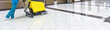 canvas print picture - Floor care with washing machine in an office lobby. Panorama of cleaning service with vacuum equipment on shiny marble floor in the luxury interior of company. Concept of professional cleaning job.