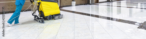 Floor care with washing machine in an office lobby Canvas