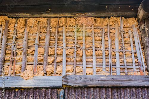 Fotografie, Obraz  日本の古い建築素材(土と藁を練り上げた壁)