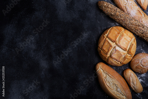 Fresh bread on a black chalkboard. Top view with copy space