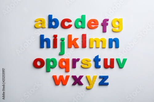 Photographie  Plastic magnetic letters isolated on white, top view
