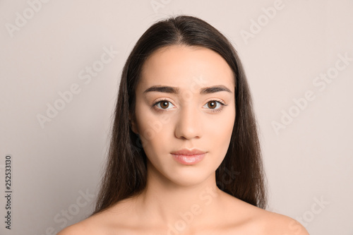 Fototapety, obrazy: Portrait of young woman on light background