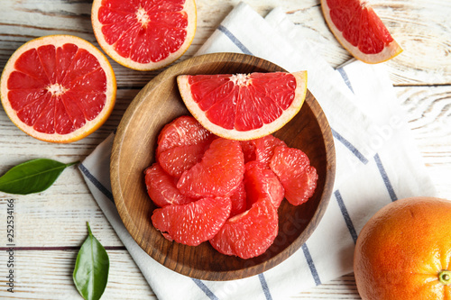 Stampa su Tela Flat lay composition with grapefruits on wooden background
