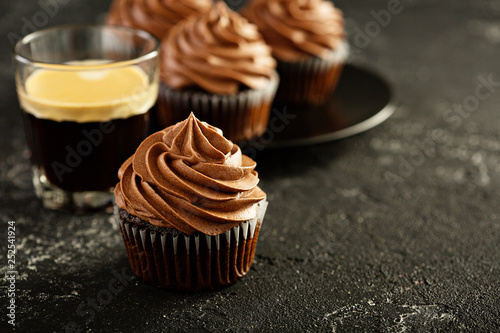 Chocolate coffee cupcakes served with espresso in a glass Canvas Print