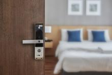 Hotel Room Opened With Digital Door Access Control, Condominium Or Apartment Doorway With Open Door In Front Of Blur Bedroom Background