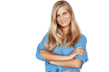FototapetaYoung beautiful girl woman blond with long hair and blue eyes in a blue shirt isolated white background