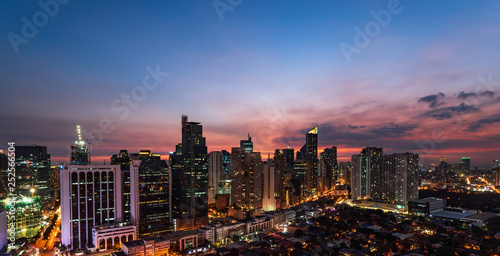 Foto auf Leinwand Aubergine lila Nightscape of Skyscrapers of Makati, Manila