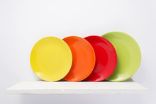 Plate At Wooden Shelf On White Background