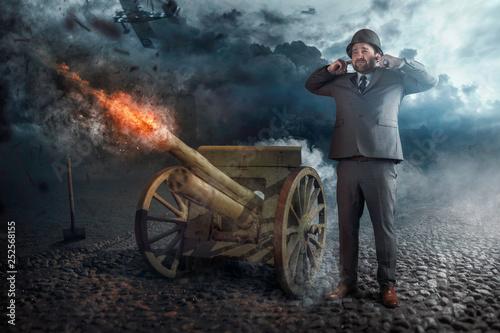Businessman firing with old cannon Tapéta, Fotótapéta