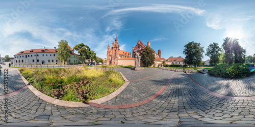 Photo  VILNIUS, LITHUANIA - SEPTEMBER 2018, Full seamless 360 degrees angle view panorama in old city with beautiful decorative medieval style architecture in equirectangular spherical projection