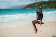 woman on a swing on a tropical island of the Seychelles on Praslin