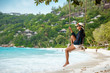 woman on a swing on a tropical island of the Seychelles on Praslin