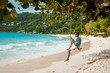 Men on a swing on the beach of the tropical Island Seychelles Prasling