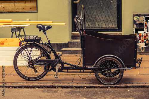 Poster Velo tricycle (bicycle) bike with a basket on the street of Copenhagen, Denmark