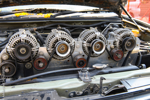 Four alternator for the car attached on engine Canvas Print