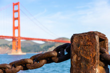 Old Rusted Chain In Front Of Golden Gate Bridge