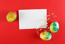 Hand Painted Tie Dye Easter Eggs Of Different Pastel Color On Bright Colorful Paper Background With A Lot Of Copy Space For Text. Top View, Flat Lay, Close Up. Blank Easter Greeting Card Concept.