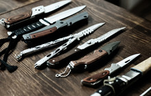 Many Different Knives On A Woo...