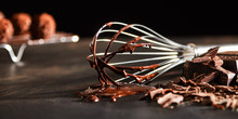 Old Metal Whisk Coated In Melted Chocolate