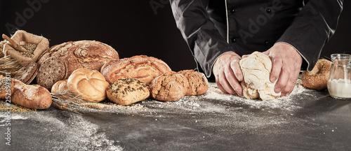 Staande foto Bakkerij Baker kneading dough to make gourmet bread