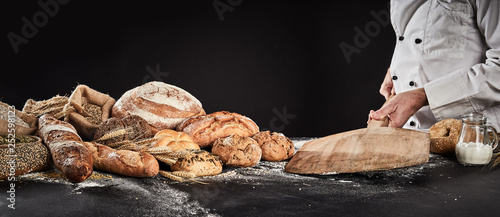 Canvas Prints Bread Baker placing an empty wooden paddle on a table
