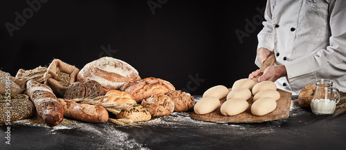 Foto op Plexiglas Bakkerij Baker holding a wooden paddle with formed dough