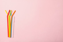 Colorful Reusable Silicone Straws And Cleaning Brush Isolated  On Pink Background, Eco Friendly Lifestyle, Zero Waste Party, Copy Space, Top View, Flat Layout