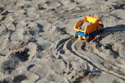 Poster Taupe toy truck on the sandbox