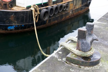 Tyres Rubber On Wooden Boat At Port Harbour